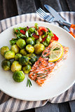 Fried salmon with lemon and brussels sprouts
