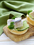 snack sandwiches with cucumber and herring