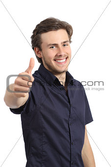 Handsome happy man gesturing thumbs up and smiling