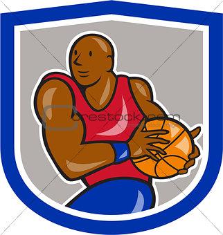 Basketball Player Holding Ball Shield Cartoon