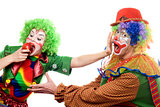 Clowns are fighting for an apple