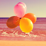 balloons in the beach with a retro effect