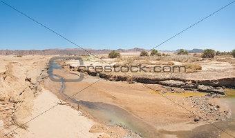 Small stream going through desert oasis