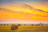 Sunrise field, hay bale in Belarus.