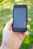 smartphone with broken screen in the hand