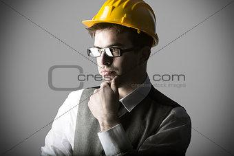 Portrait of thoughtful smart young engineer