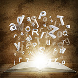 Letters are emitted from an open book