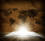 Over an open book is a map of the earth
