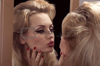 vain girl in front of the mirror