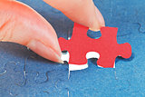 attaching the last red piece of puzzle