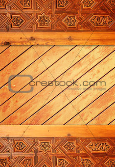 Background with ancient carved wooden ornament