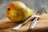 Juicy pear on a cutting board.