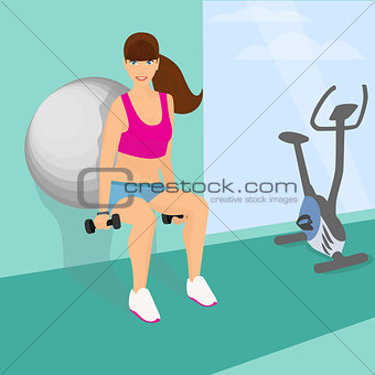 Beautiful woman squats using fitness ball with dumbbells in her hands (lower position)