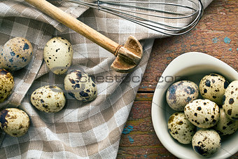 top view of quail eggs on old wooden table