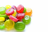 colored caramel fruit candies on a white background