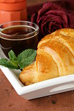 elegant coffee break or breakfast cup of coffee and croissant