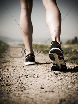 Legs and shoes of a runner