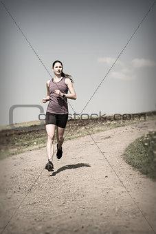 Woman jogging down gravel road