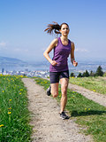 Young fit woman running in spring