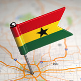 Ghana Small Flag on a Map Background.