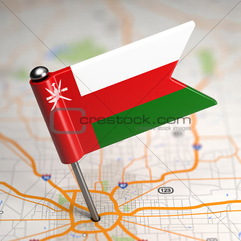 Oman - Small Flag on a Map Background.