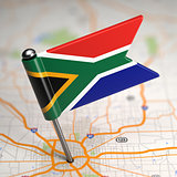 South Africa Small Flag on a Map Background.