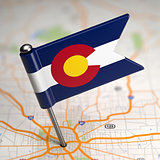 Colorado Small Flag on a Map Background.