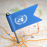 United Nations Small Flag on a Map Background.