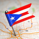 Puerto Rico Small Flag on a Map Background.
