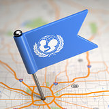 UNICEF Small Flag on a Map Background.
