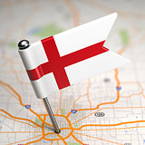 England Small Flag on a Map Background.