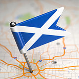Scotland Small Flag on a Map Background.