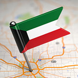 Kuwait Small Flag on a Map Background.