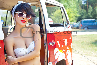 a beautiful retro-looking girl with red lips in sunglasses