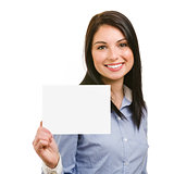 smiling young woman showing blank signboard