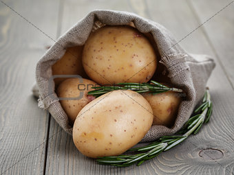 baby potatoes in sack bag with rosemary