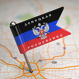 Donetsk People's Republic Small Flag on a Map Background.