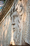 face of a man with a beard carved in stone