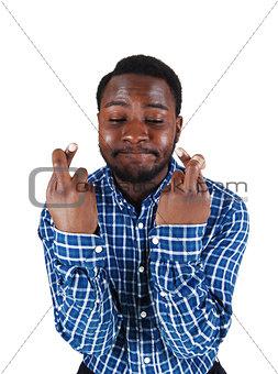 Black man crossing finger.