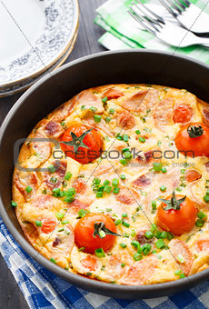 Omelet with ham and cherry tomatoes