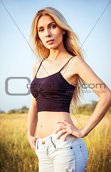Portrait of beautiful young woman amongst the field