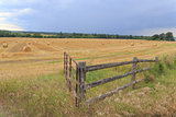 Farmers field with a fence