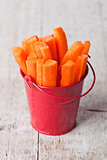 fresh sliced carrot in red bucket