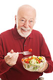 Senior Man Eats Salad