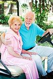 Seniors In Golf Cart