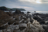 Hope Cove sunset landscape seascape with rocky coastline and lon