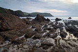 Hope Cove sunset landscape seascape with rocky coastline and lon