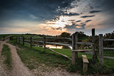Sunset landscape across English countryside with dramatic sky