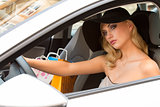 blond elegant girl in car looking
