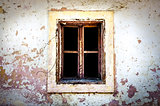 Old damaged window on textured wall